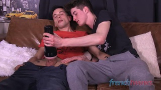 two guys surprise buddy stroking his cock