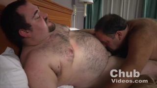one hairy chub blowing another