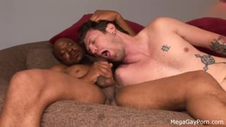 tatted white boy services a big black dick