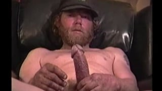 bearded redneck jerks his skinny cock