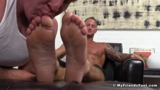 foot piggy goes nuts for hunk's big feet