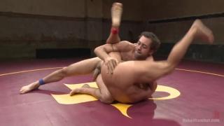 winning wrestler pounds the loser's ass