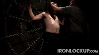 slave tied to spider web of chain