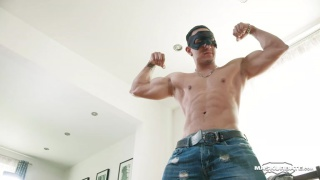 masked hunk carlos flexes in jeans