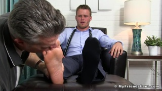 handsome Shawn Reeve in suit gets feet worships
