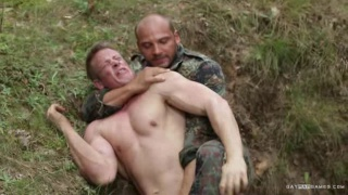 soldier jumps hiker in the woods