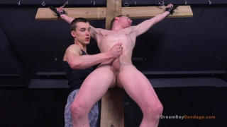 Michael Del Ray strung up on cross and jacked off