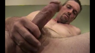 ruggedly handsome working man jerks his cock