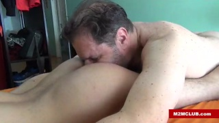big bear hands his bottom over to another man