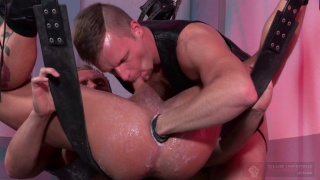 Brian Bonds fists Preston Johnson in leather sling