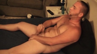big hairy stud jerks his cock