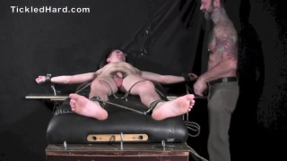 22-year-old guy strapped onto the tickle table