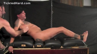 inked stud carlos gets his bare feet tickled