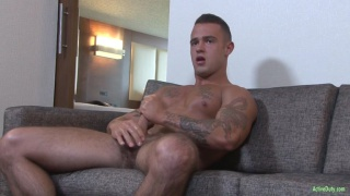 inked stud johnny jerks his cock