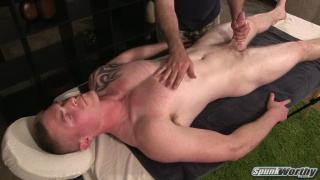 logan gets his big dick stroked on massage table