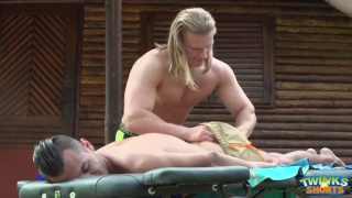 masseur with long blond hair services his younger client