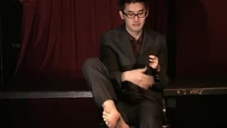 asian guy in suit peels off his socks
