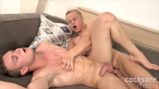 Peter Comely bare fucks Cody Donal on the couch