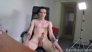 skinny lad strokes his massive dick