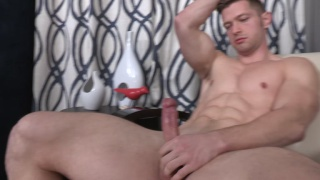 deacon plays with his big, uncut cock