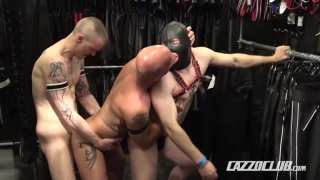 cock pigs fuck in a leather clothing store