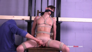 beautiful boy Aiden is roped to bondage chair