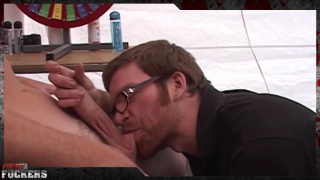 cocksucker with glasses sucks a guy's nuts