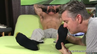 Chase Lachance gets his bare feet massaged
