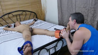 daddy ties up his asian boy and licks his feet