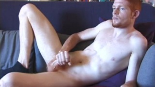 ginger guy strokes his dick