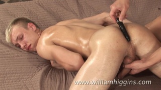 blond czech stud gets fingered on the massage table