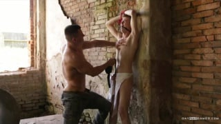 soldier ties his captive to a wall and has fun