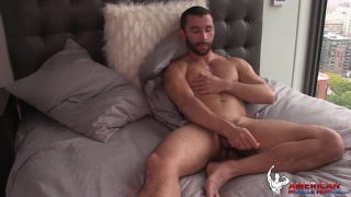 bearded hunk luca jacks his dick