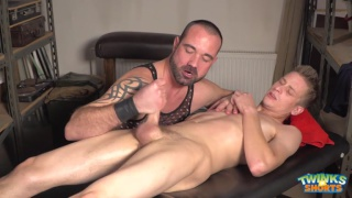 blond twink gets massage from bearded hunk