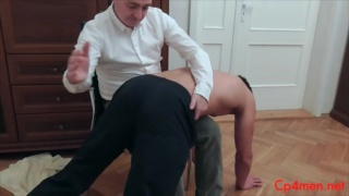 spanking master take swimmer over his knee