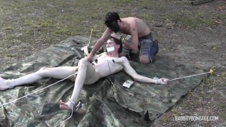 boy toy Damien Rage roped to the ground