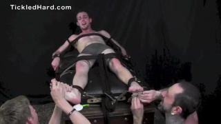 Branson is tied down and tickled by two men