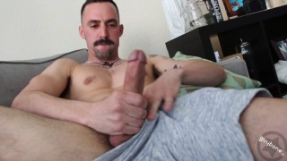 sexy guy with mustache jerks his dick