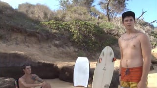 surfer boys jack off together on the beach
