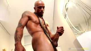 bald black hunk jerks his two-handed cock