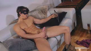masked stud jerks his big cock