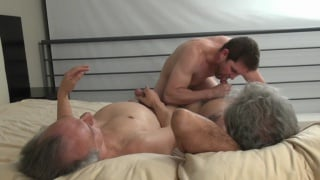 muscled lad blows two silver daddies side by side