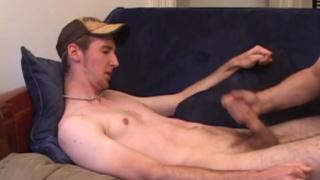 guy in baseball cap gets stroked off