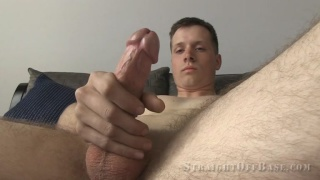 blond corporal strokes his big-nobbed cock