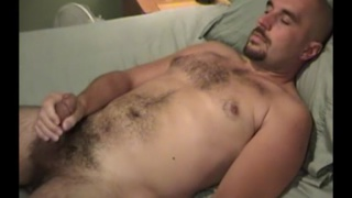 handsome hairy man jacks off while his wife waits