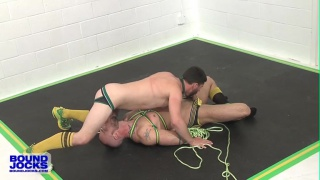 roped hunks roll around on the mats in their jockstraps