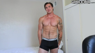 muscle jock plays with his nipples while jerking off
