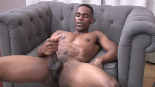 lean black stud jerks his cock