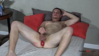 straight guy jerks off with red butt plug up his ass