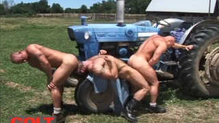 3 muscle hunks fuck on a farm tractor